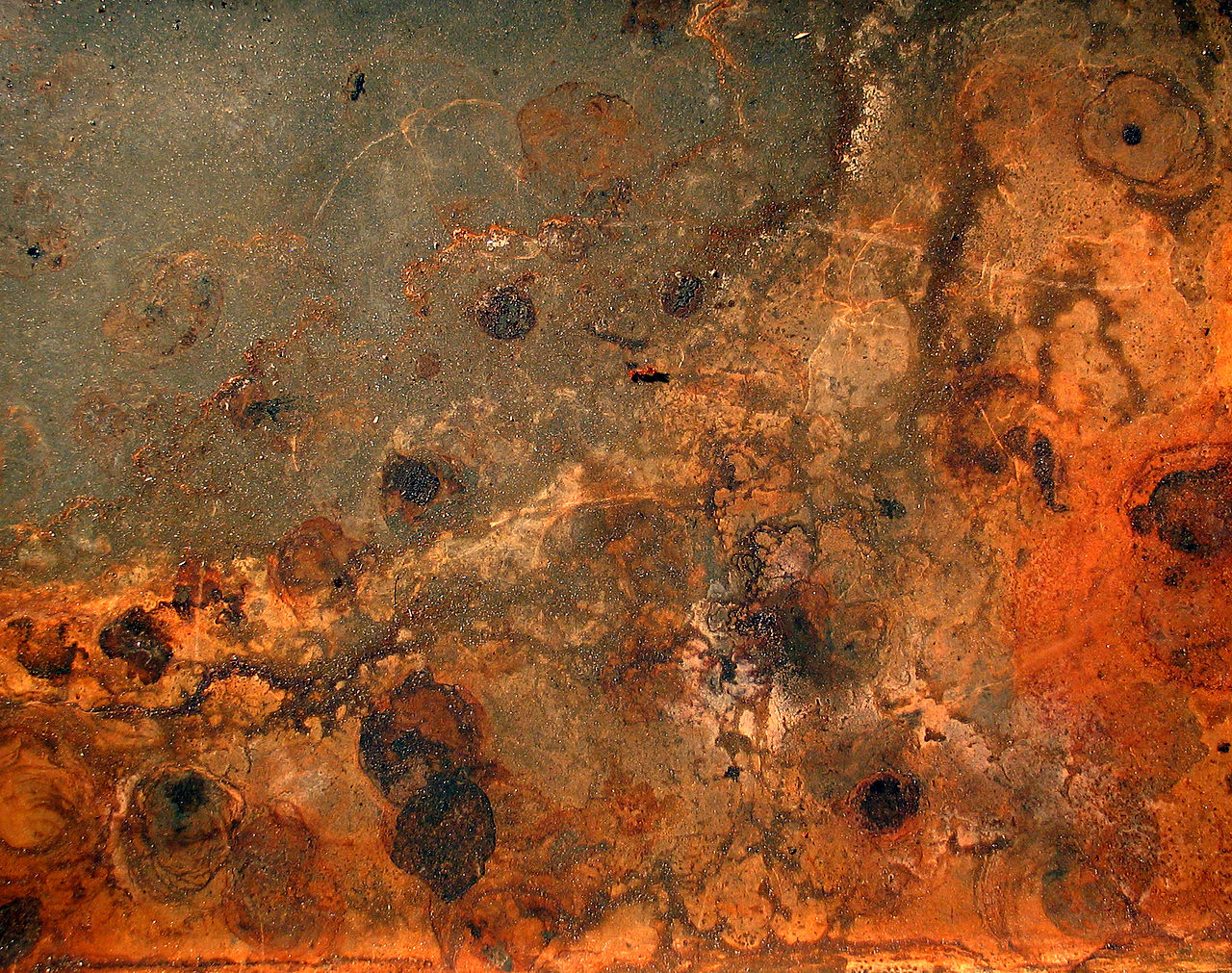 A photograph of rust and dirt.